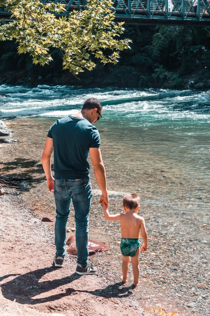 Father and Sun by the river