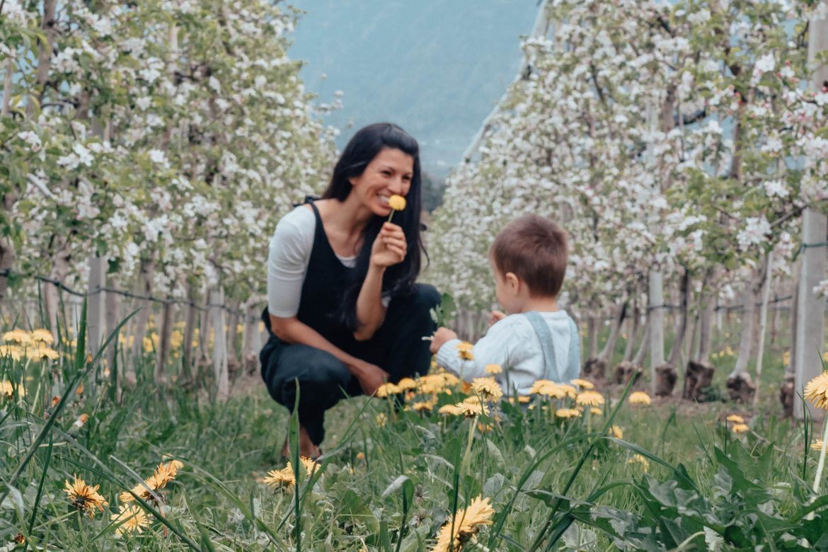 a child picks his mother a flower