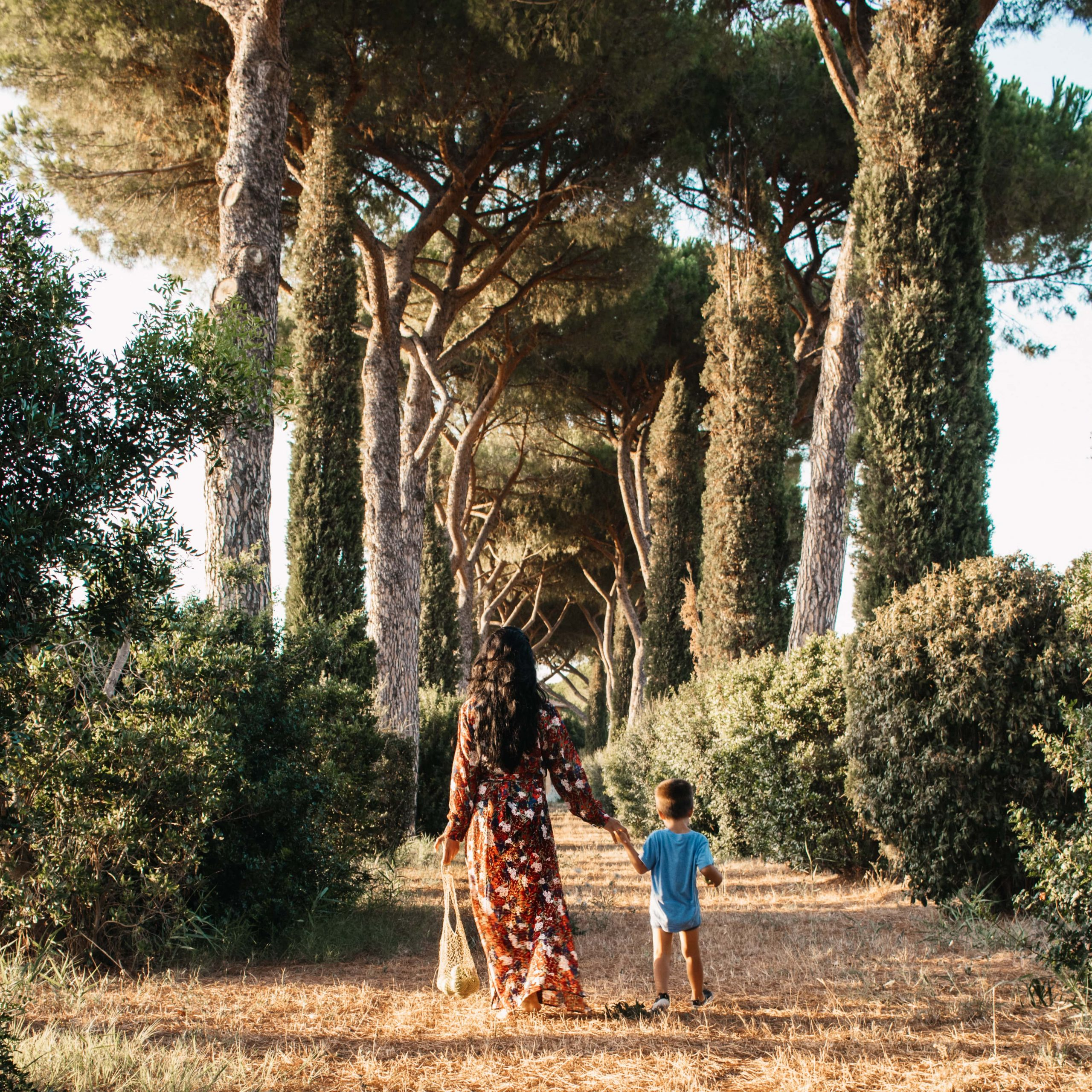 Mother and Son walking through Tuscany