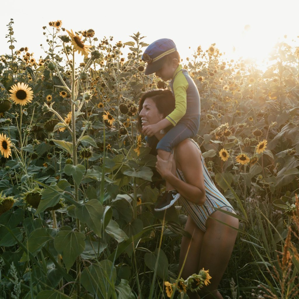 Mother and Son in Sunflower Field